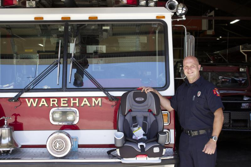Wareham Firefighter Dana Lofgren Performs Car Seat Inspections And Installations At The Fire Department BY BILL WHELAN