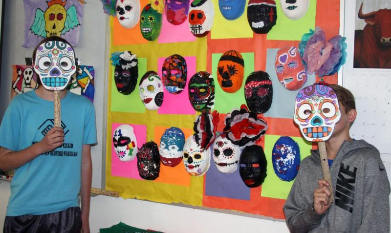 Anthony Beluso Left And Chase Colon Show A Display Of Masks Decorated By Middle School Students BY LYDIA GOERNER